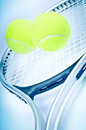 Tennis racket and two balls Stock Photo