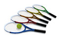 Tennis rackets five in a variety of colors and a ball against a white background Stock Photo
