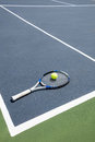 Tennis racquet and ball in court Royalty Free Stock Photo
