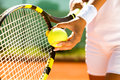Tennis serve player s hand with ball preparing to Royalty Free Stock Images
