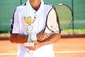 Tennis winner player with golden goblet Stock Images