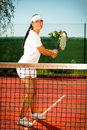 Tennis young girl playing outdoor Royalty Free Stock Photos