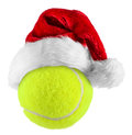 Tennisball santa hat on tennis ball on white background Stock Images