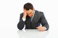 Tensed business man holding his head in pain Royalty Free Stock Images