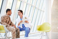 Tensión del doctor Counselling Soldier Suffering From Imagen de archivo