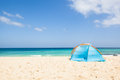 Tent at the beach camping with a a lonesome with a turquoise sea and blue sky in background fuerteventura canary islands spain Royalty Free Stock Photos