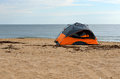 Tent on beach with sea in background Stock Photography