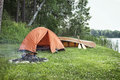 Tent, campfire and canoe on Minnesota lakeshore Royalty Free Stock Photo