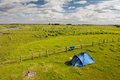 Tent on camping grass in beautiful landscape of poland Royalty Free Stock Photo