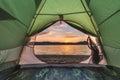 Tent green on lake coastline closeup Royalty Free Stock Photos
