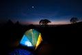 Tent illuminated yellow camping at night Royalty Free Stock Photos