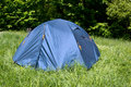 Tent on meadow tourist green Stock Photography