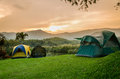 Tent set on the grassland of mountain in sunrise Stock Image