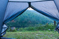 Tent standing on a grass side swamps in mountains Royalty Free Stock Image