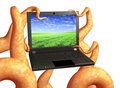 Tentacles of a monster, holding a laptop Stock Image