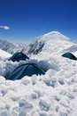 Tents of assault camp in high altitude on the mountain ridge Royalty Free Stock Photos