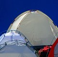 Tents igloo for the adventurous expedition around the world and blue background Royalty Free Stock Photos