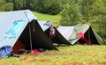 Tents in a scout camp and drying laundry out to dry Royalty Free Stock Photo