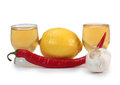 Tequila cups and garlic Royalty Free Stock Photo