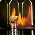 Tequila shot flaming background Royalty Free Stock Photography