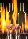 Tequila shot flaming background Royalty Free Stock Photos