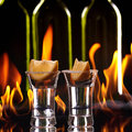 Tequila shot flaming background Royalty Free Stock Images