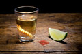 Tequila shot with lime and salt on vintage background Stock Image