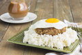 Teriyaki loco moco a traditional hawaiian dish of teriyaka flavored ground beef patty and a fried egg on a bed of rice smothered Stock Image