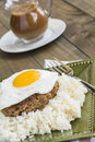 Teriyaki loco moco a traditional hawaiian dish of teriyaka flavored ground beef patty and a fried egg on a bed of rice smothered Royalty Free Stock Image