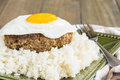 Teriyaki loco moco a traditional hawaiian dish of teriyaka flavored ground beef patty and a fried egg on a bed of rice smothered Stock Photos