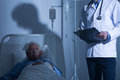Terminally ill patient in hospice male staying Royalty Free Stock Photos