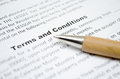 Terms and conditions with wooden pen Stock Photos