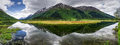 Tern lake in summer on the kenai peninsula in alaska is vibrant with life and reflections Stock Image