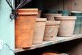 Terra Cotta Pots on Shelf Royalty Free Stock Photo