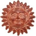 Terra cotta sun face Royalty Free Stock Photo