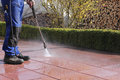 Terrace cleaning with high pressure worker ist the Royalty Free Stock Photo