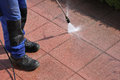 Terrace cleaning with high pressure worker ist the Stock Images