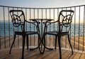Terrace lake view with iron chairs and table Royalty Free Stock Photo