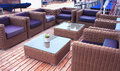 Terrace lounge with rattan armchairs and sea view Royalty Free Stock Photo