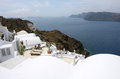 Terrace with lounges on santorini island and sea in greece Royalty Free Stock Images