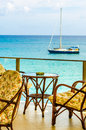 Terrace by the sea side with boat chairs and table in background Royalty Free Stock Photos