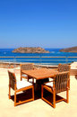 Terrace seaview with outdoor furniture (Crete, Royalty Free Stock Photo
