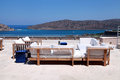 Terrace seaview with sofa (Crete, Greece) Royalty Free Stock Photo