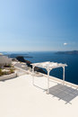 Terrace with Sunshade on Santorini Greece Royalty Free Stock Photography