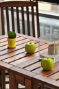 Terrace table and decoration decorated with two ceramic apples a plant Royalty Free Stock Images