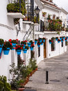 Terraced white houses in andalucia spain decorated the traditional style with colourful flower pots mijas one of the villages of Royalty Free Stock Photography
