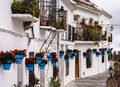 Terraced white houses in andalucia spain decorated the traditional style with colourful flower pots mijas one of the villages of Royalty Free Stock Photos