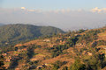 Terraces of nagarkot the snow capped mountain peaks the himalayas against a perfect blue sky with the below Stock Photo