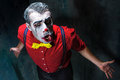 Terrible clown and Halloween theme: Crazy red clown in a shirt with suspenders Royalty Free Stock Photo