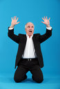 Terrified businessman on his knees Stock Photography